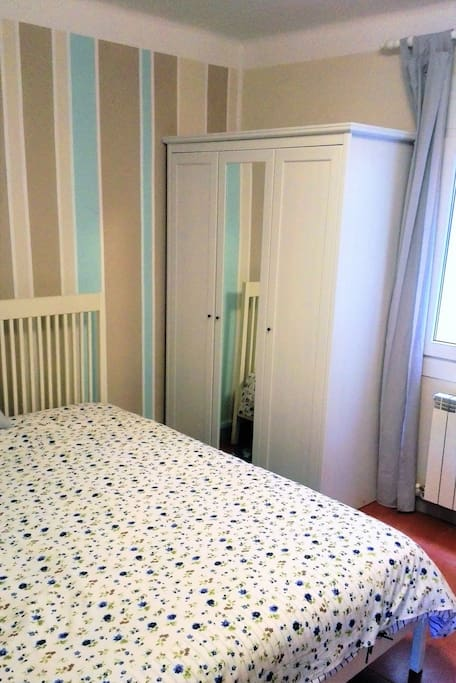 Spacious back double bedroom with extra single bed