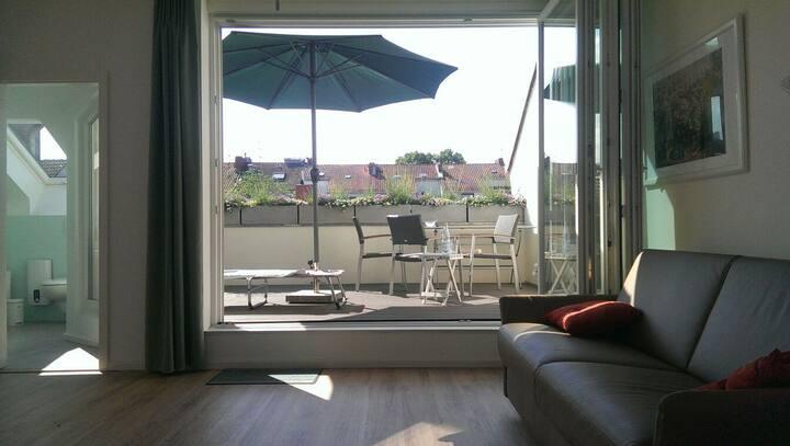 Helles Apartment mit Dachterrasse