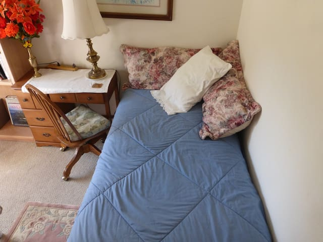 single bed in shared dormitory. clean sheets and one towel per guest.