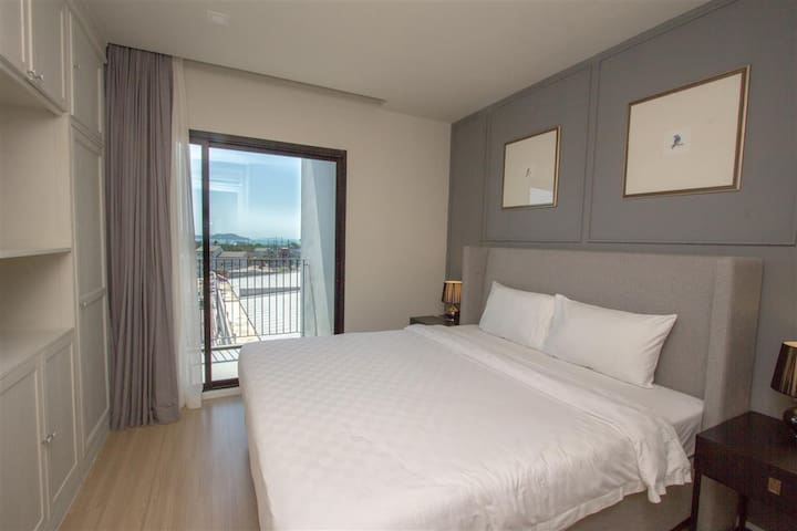 Main room has a king size bed with sea view.