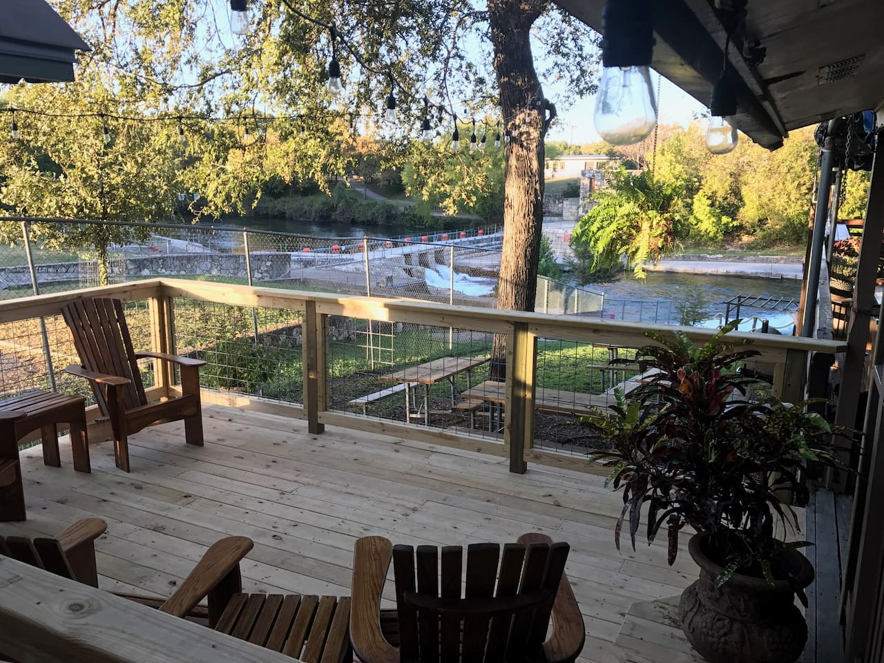 Private deck overlooking the city tube chute on the Comal River.