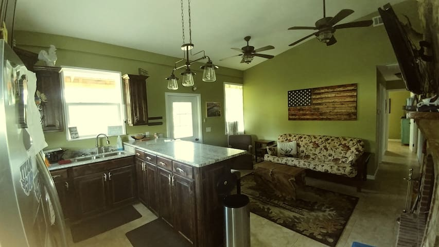 Great room with views of the river. Granite counter tops. Large TV and surround sound system. Wood burning fire place