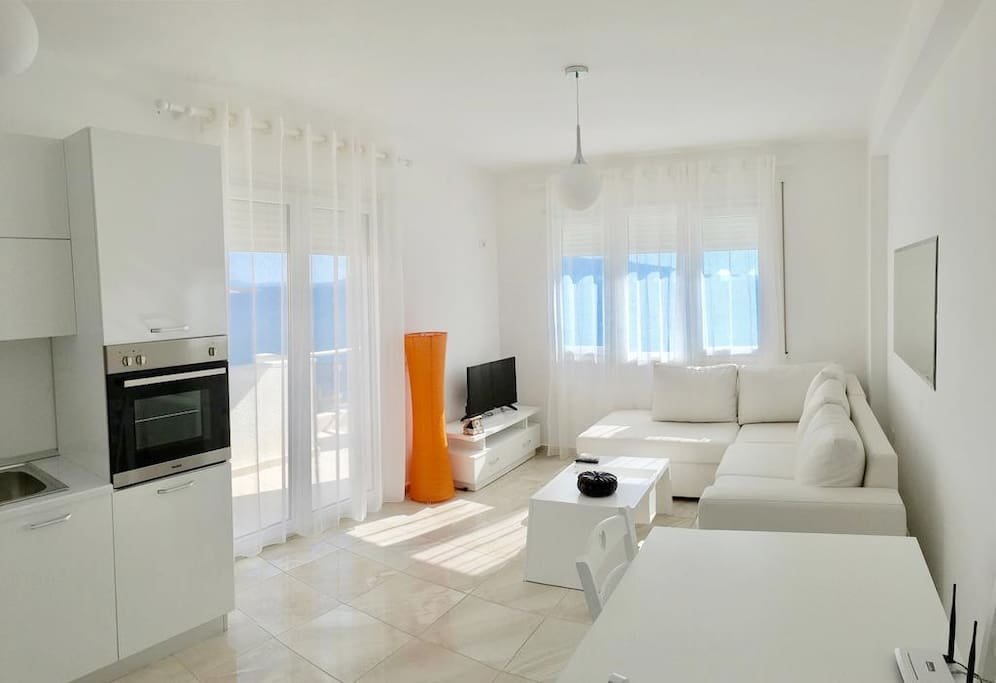 living area with sea view, smart tv, air condition, wifi,  and  2 sofa beds