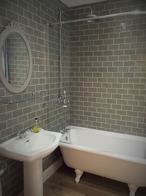 Bathroom with roll top bath and powerful shower