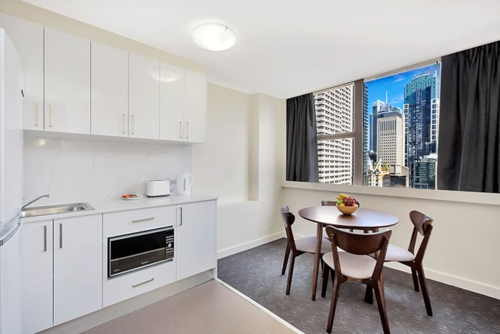 Dining setting with City & Hyde Park Views. Self contained kitchen with full sized fridge/freezer.