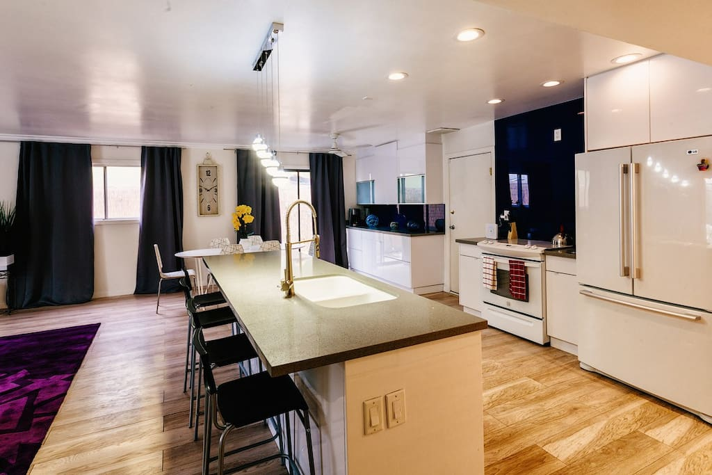 Central countertop with bar seating.