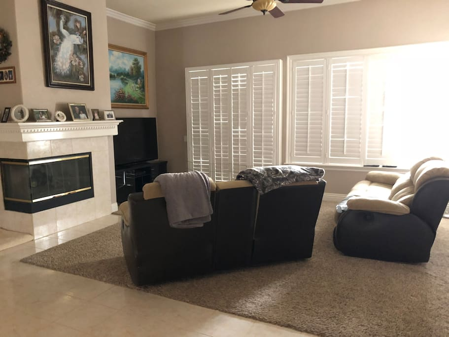Family room with tv and fireplace that you may use