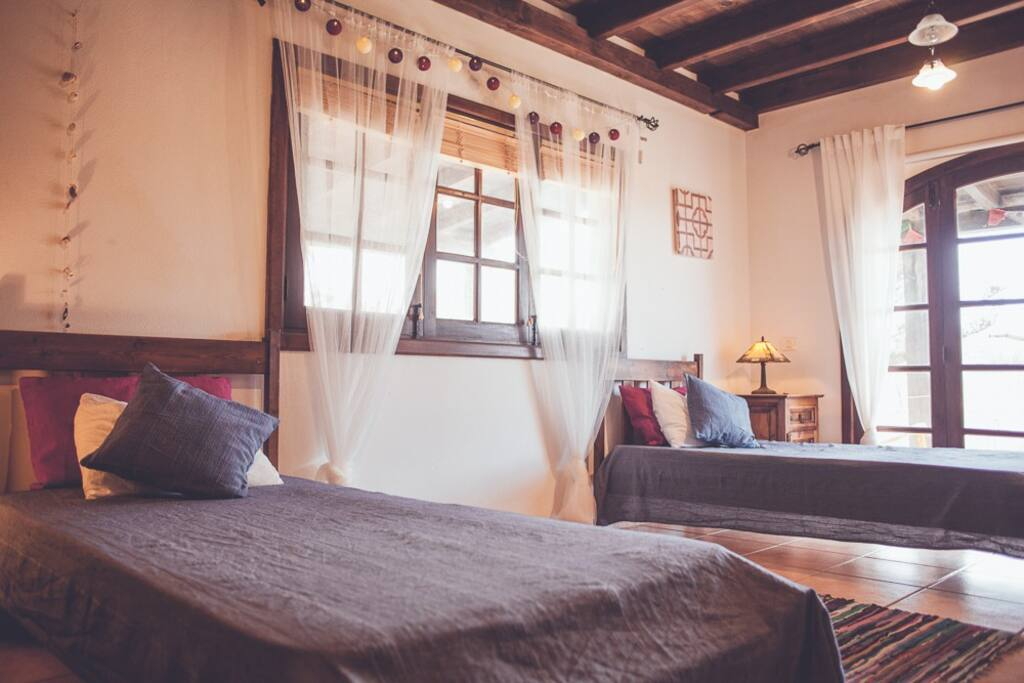 twin beds in warm and bright atmosphere