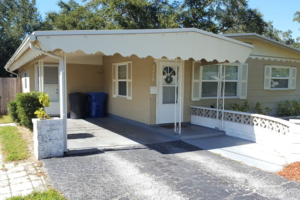 Pull in to your private drive complete with covered carport and 2 entryways