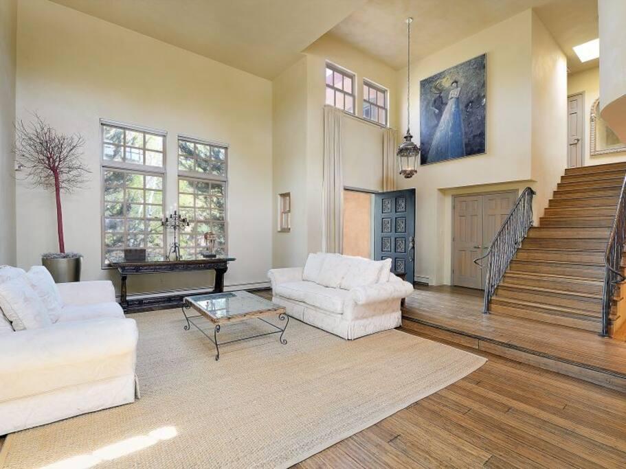 Living Room with Clerestory Ceilings, Hardwood Floors, Privacy, Designer Furniture, & Fine Art.