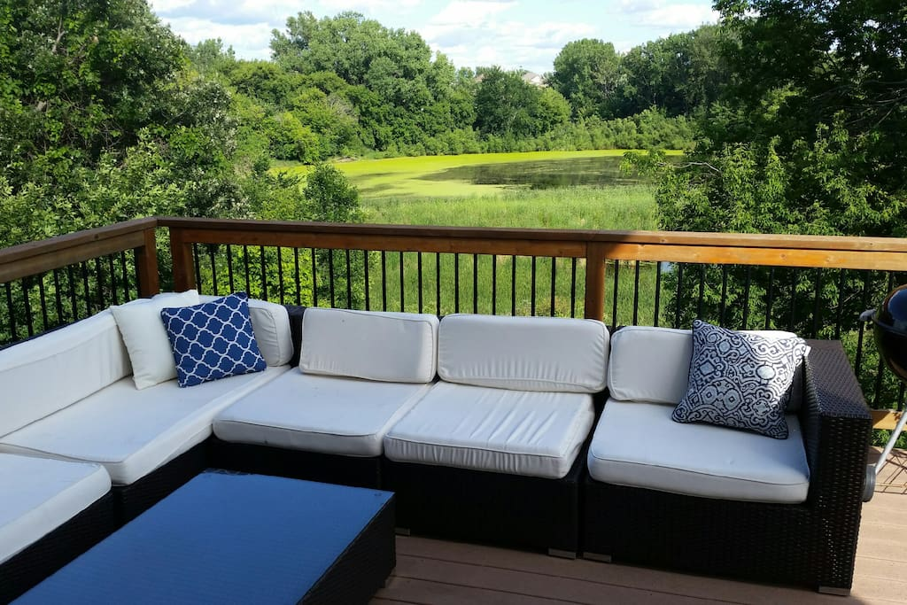 Backyard deck w/ fire table overlooking Lake Riley and protected wetlands