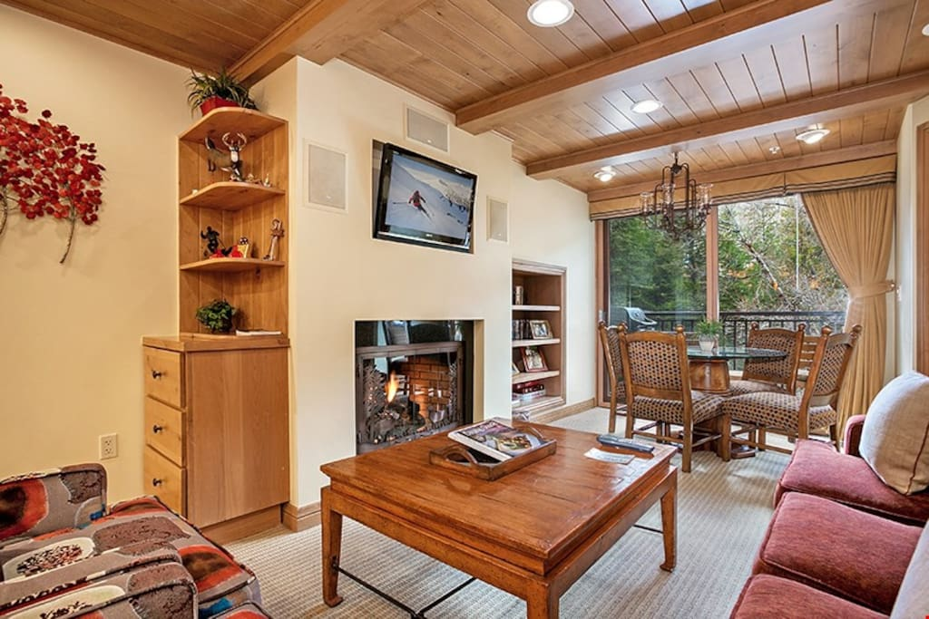 Kick back and relax in the spacious living area, complete with fireplace.