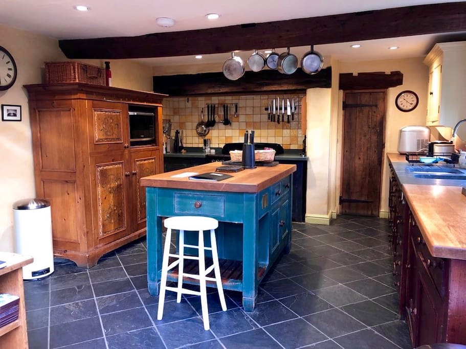"""Beautiful fitted """"Chalon"""" Kitchen with Rangemaster cooker and walk in larder viewed from adjoining dining area in the conservatory."""