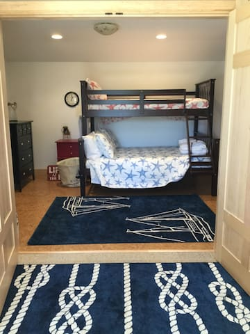 2nd bedroom: Bunk with full size on bottom and single on top bunk.