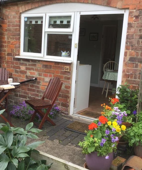 Main Cottage entrance (to the rear of the cottage) with outside eating area.....