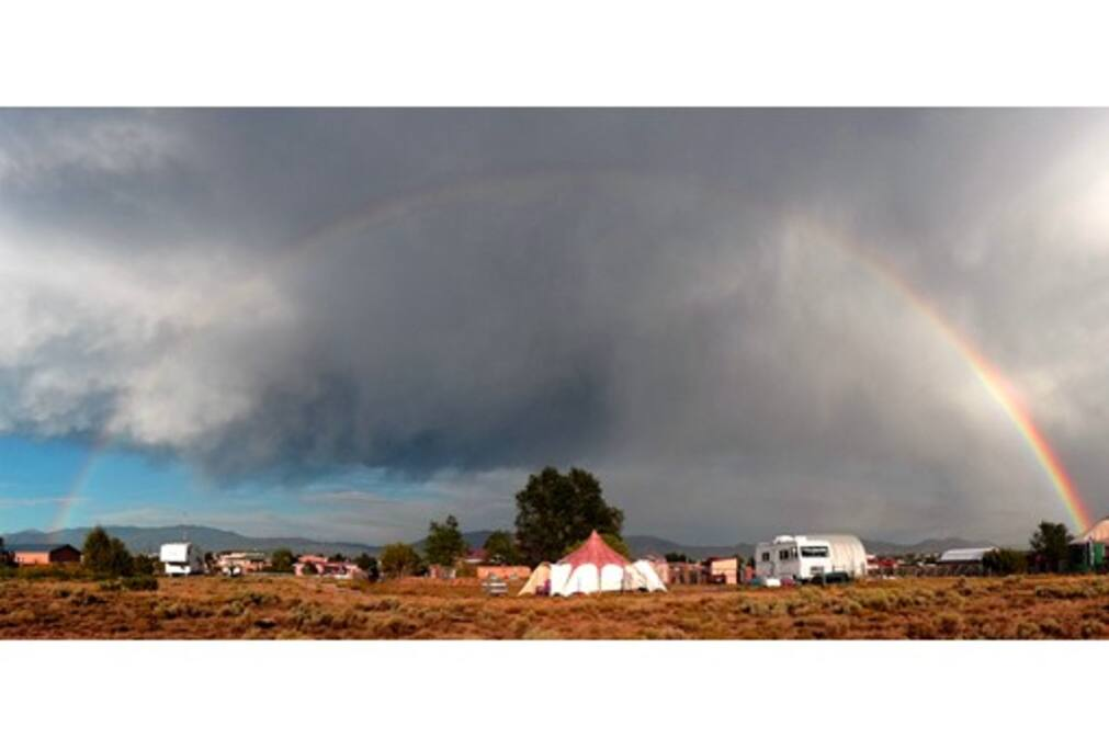 This is the view of the entire rainbow, the property surrounding the Lotus Belle and the Sangre De Cristo mountains behind.