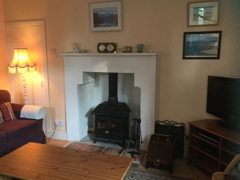 The lounge seats 6 and has a wood burning stove. There is Freeview TV and a DVD player.