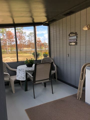 Fully screened in porch to enjoy morning coffee or evening sunsets while playing games or relaxing.