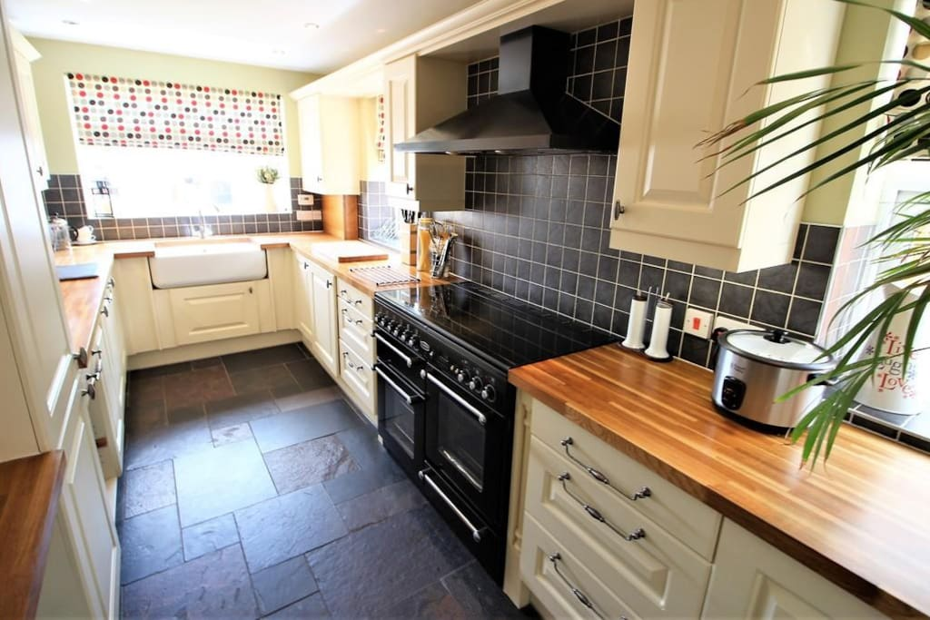 Country style kitchen with range cooker, dishwasher and washing machine
