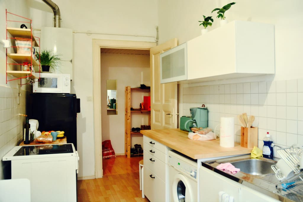 The kitchen is full of light, and equipped with everything needed for cooking and dining