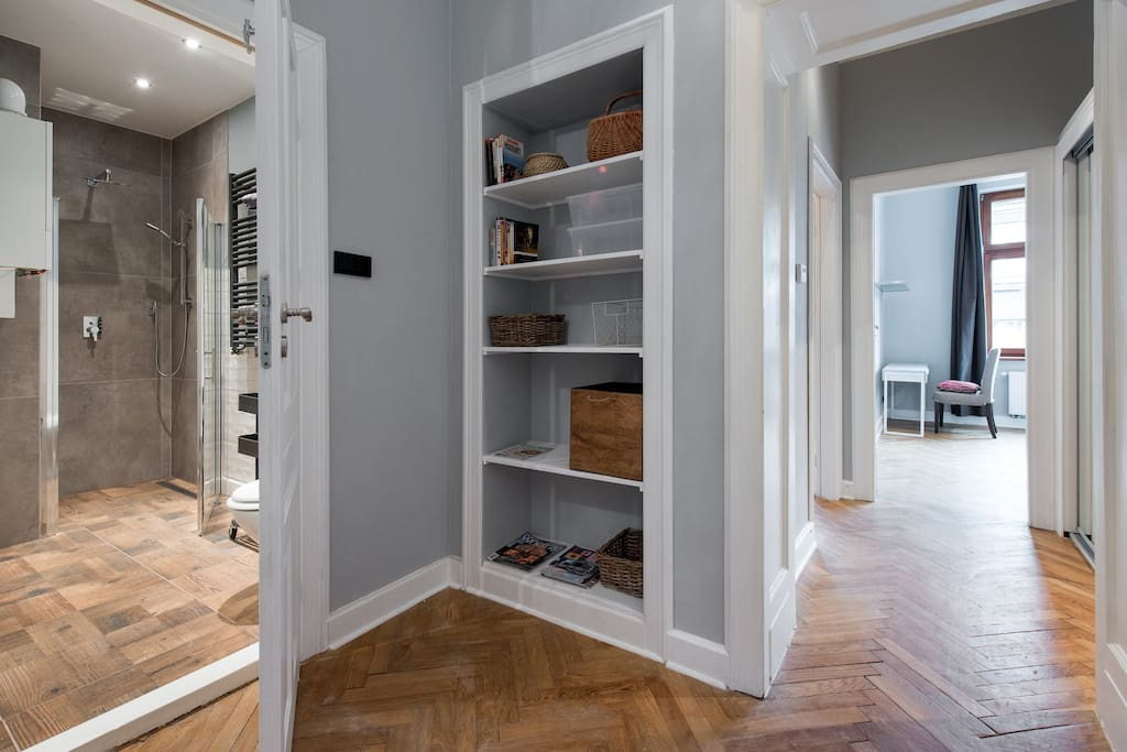 Loft style bathroom, hallway with bookcase