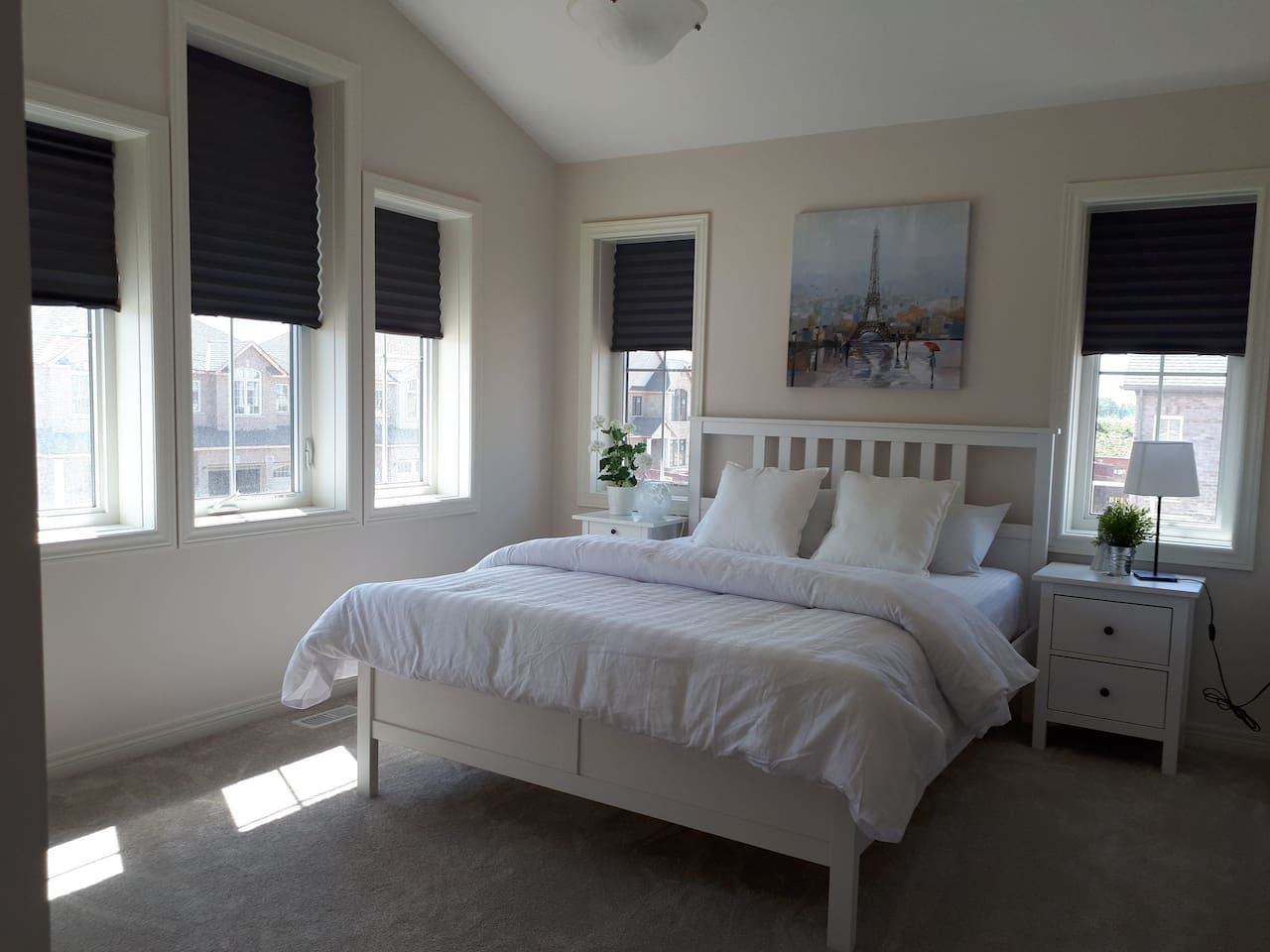Gorgeous bedroom. The blinds pull down for black out effect!