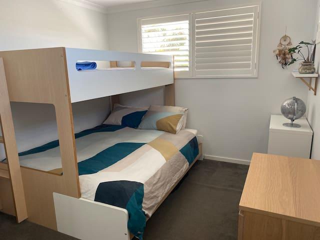 Bedroom with bunk king single over queen
