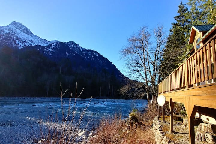 Riverfront Family Cabin w Stunning Mtn Views, Hot Tub, WiFi, Games and Fire Pit!