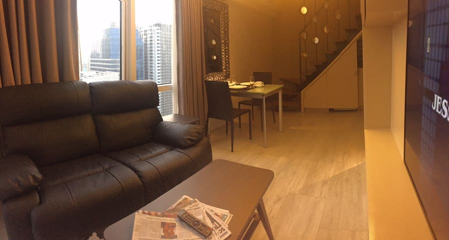 Lazy boy couches in the living room and a dining area
