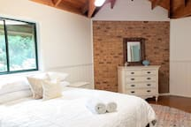 Luxury bed with quality linens, gorgeous high wooden ceilings