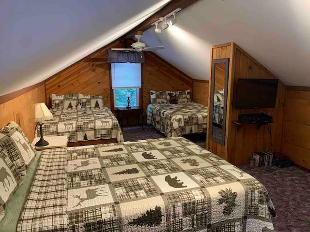 """The upstairs loft bedroom has all new beds and mattresses. There is a nice area with a 32"""" flat screen TVs and DVD player."""