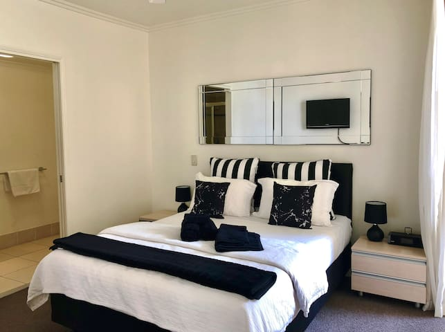 The second bedroom has a comfortable queen-sized bed, topped with hotel quality linens for a good night's sleep.