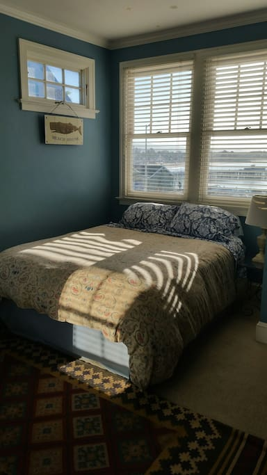Queen bed with water and Boardwalk views.
