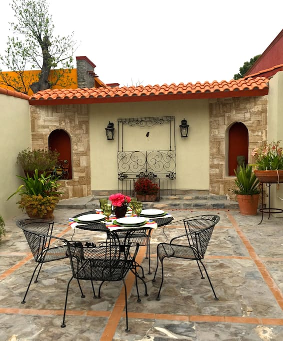 The tranquil back patio is conducive for summer reading, sipping cocktails or dinning al fresco. Patio includes a bar-b-que grill for family meals.