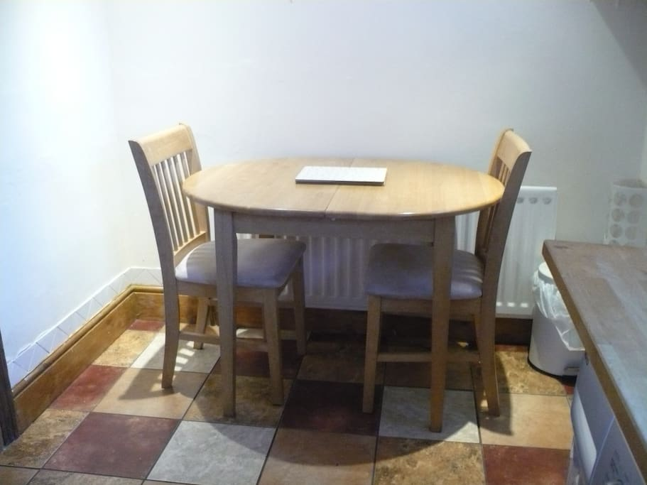 Dining table + 4 chairs for guests!
