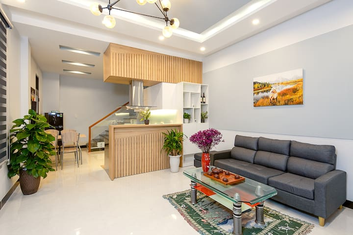 Living room is 30m2, with sofa, table and a 40-inch TV. The room is designed in a modern style, a harmonious combination of greenery and decorative objects, creating a cozy sum room for your family or group of friends. Thank you so much !