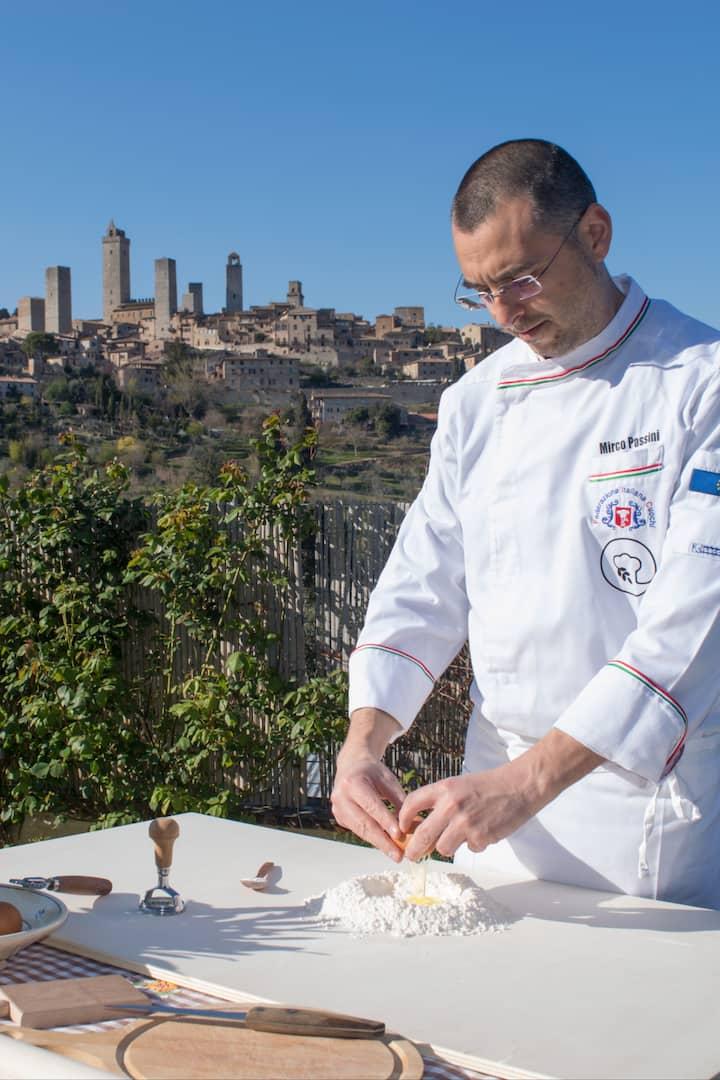 Mirco prepares pasta dough: eggs, flour