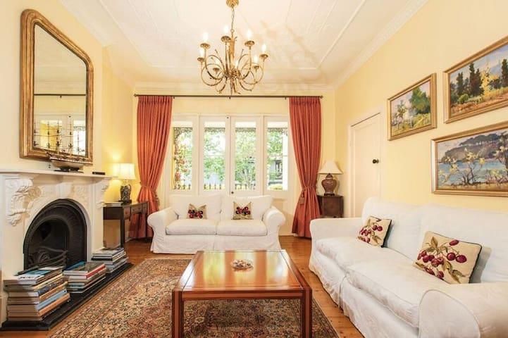 Lovely elegant lounge boasting high ornate ceilings & lovely polished floors