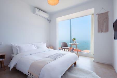 [连岛]里岸民宿~全海景落地窗大床房B