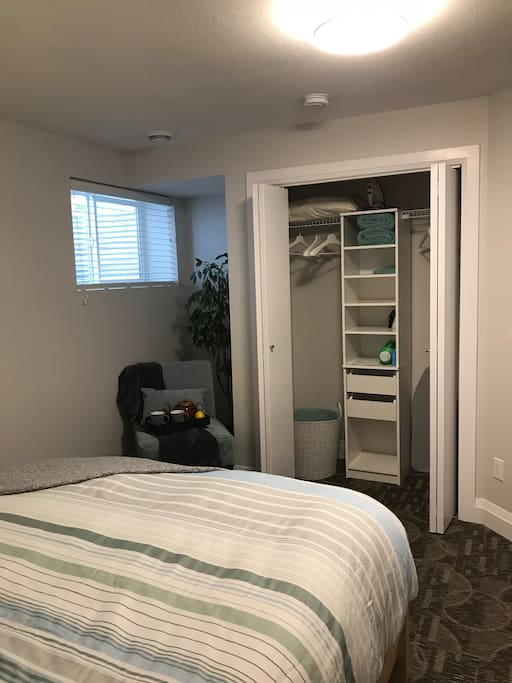 Full size closet with drawers, shelves and hangers. Includes iron and iron board.