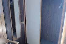 Bison Room Bathroom w/small shower, toilet, sink and closet