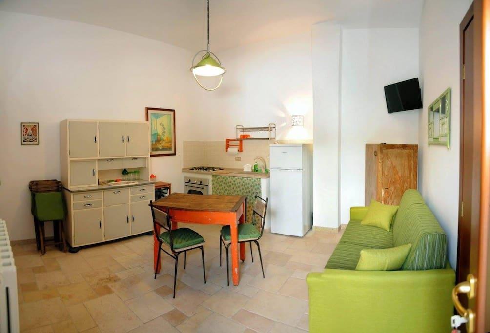 casa verde, soggiorno con divano letto