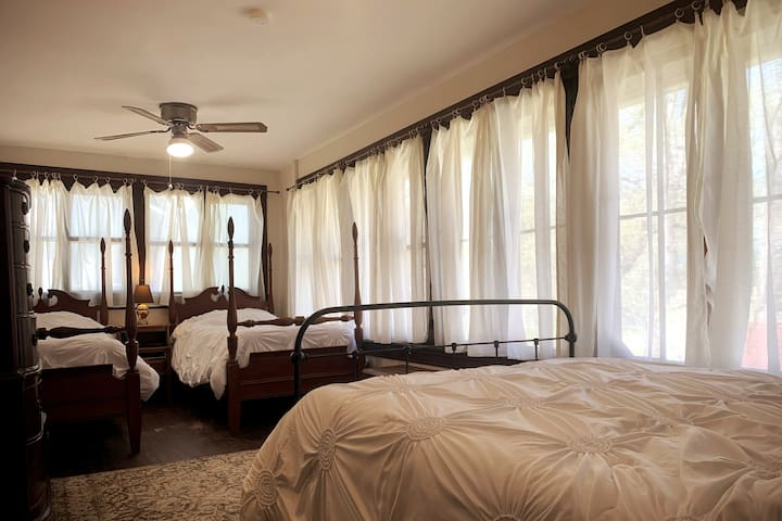 Bedroom 6 has a double bed and two single beds.