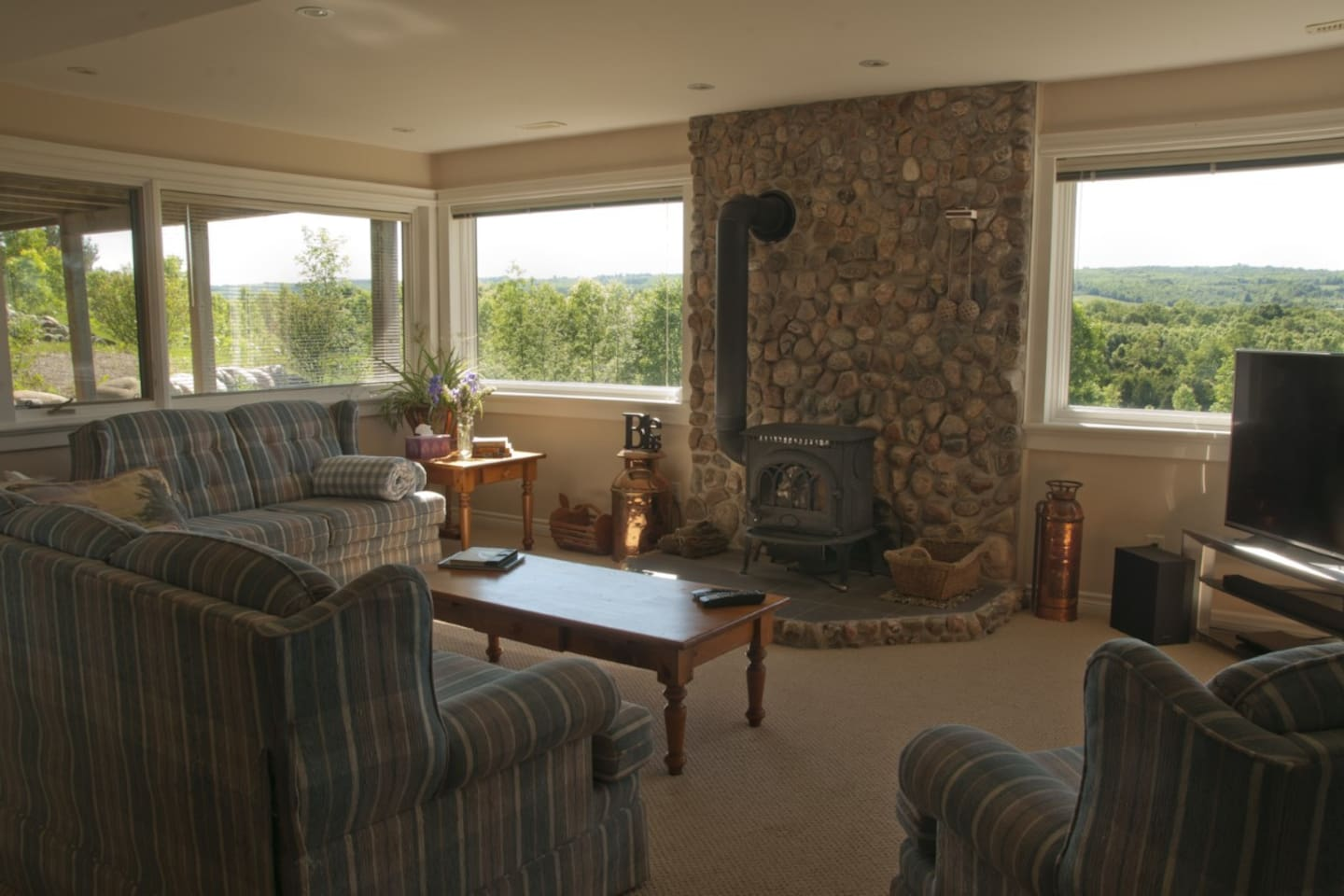 """Your private living room complete with fireplace, 55"""" LG smart TV and views to die for!"""