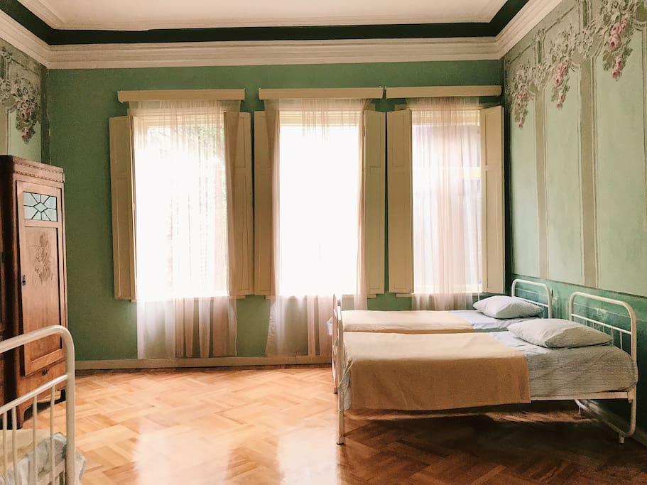 bedrooms have wooden shuttered windows.