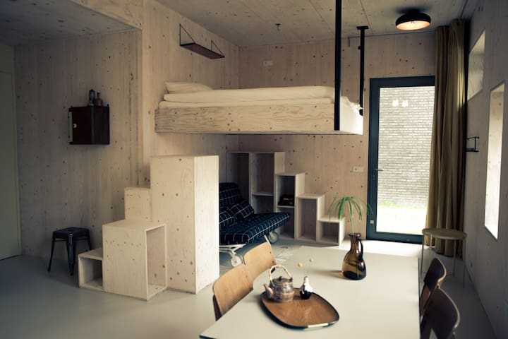 Private studio in Wooden Eco Home including bikes