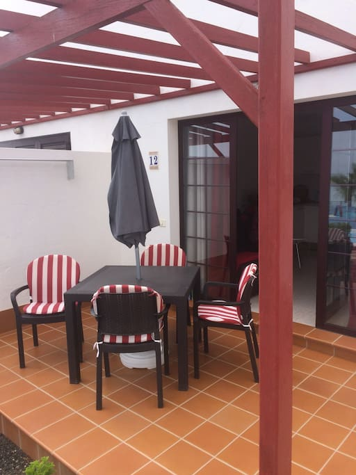 Outside patio area which receives the morning sun first thing in the morning, until around 4pm, complete with table and chairs for guests to relax. Parasol also provided, it does get rather hot.
