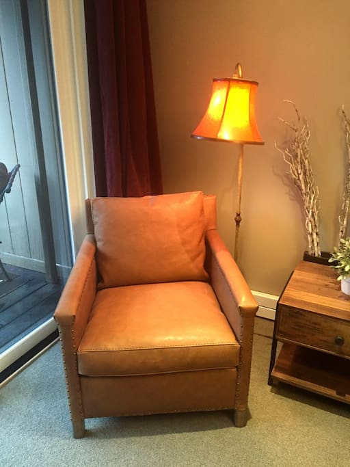 Nice leather chair to sit and read in and look out the window or at the fireplace.