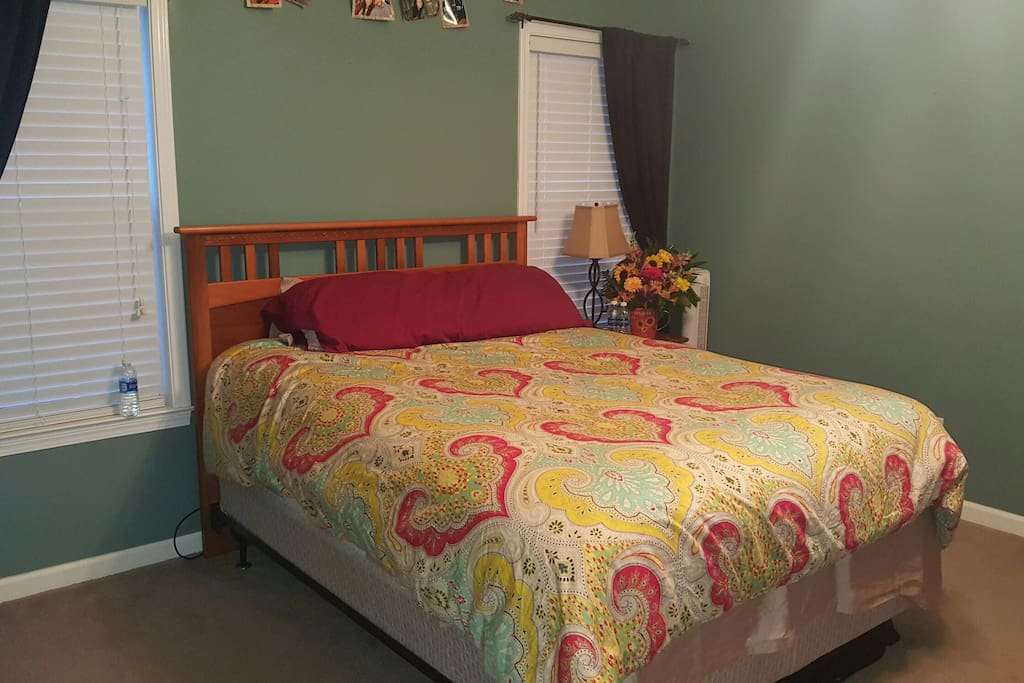 Bedroom number 1 - Master bedroom. Queen bed, sleeps 2 comfortably. Has 50 inch TV on the wall for your entertainment! This room also has a large walk in bathroom with 2 closets, a stand up shower, double sinks, and jacuzzi tub!