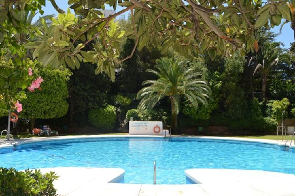 The shared swimming pool is set in pretty gardens with a large separate pool for children